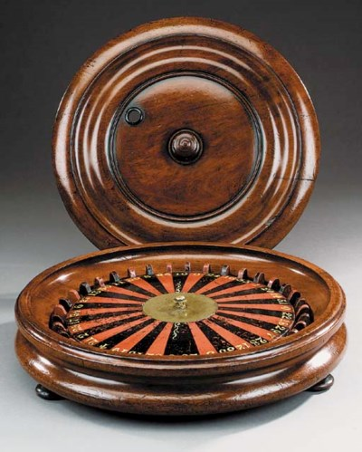 A mahogany framed roulette whe