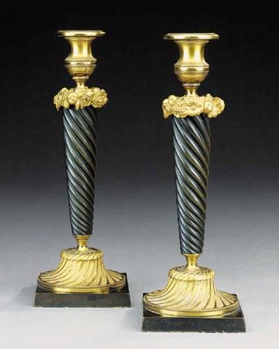 A pair of Regency style gilt a