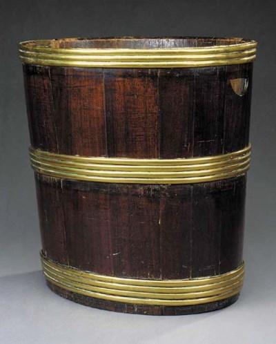 A brass bound mahogany log bin