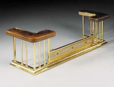 A polished brass club fender,