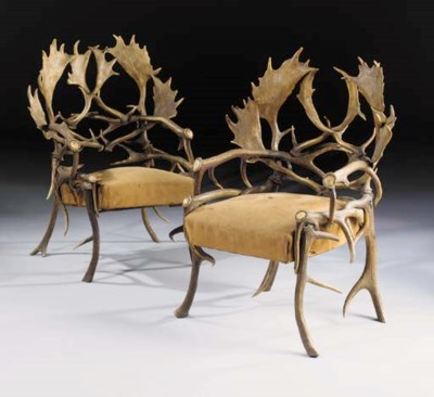 A pair of Antler armchairs, la