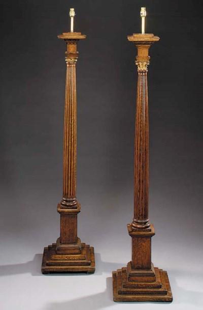 Two oak floor standing lamps,