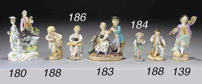 A Meissen group of vintner and