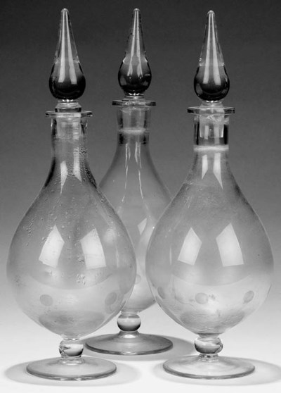 A trio of white-water carboys,