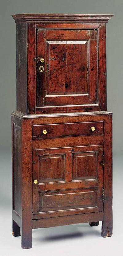 An oak upright cupboard, proba