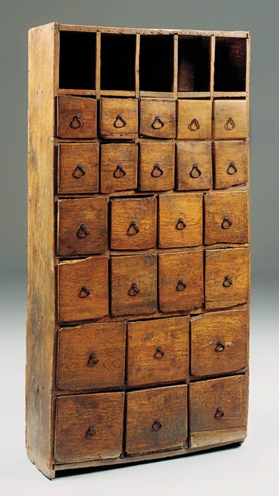 An upright elm cabinet of draw