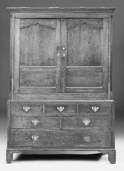 An oak press cupboard, North C