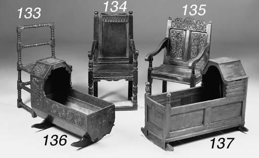 An oak cradle, English, 18th c