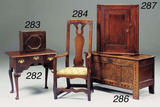 A carved and inlaid oak chest,