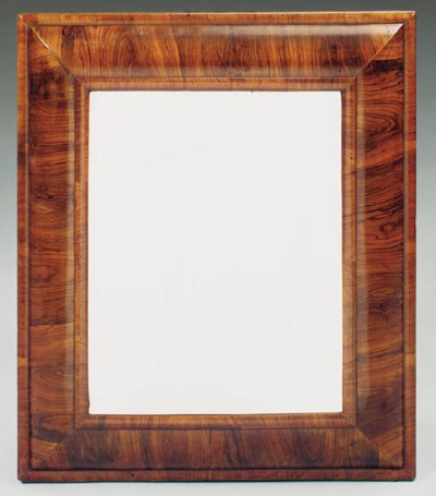 A walnut framed wall mirror, E