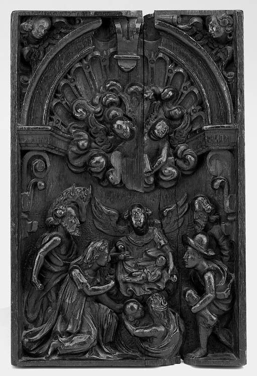 A stained carved relief oak pa