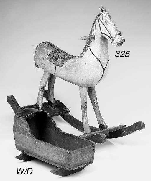 A polychrome wood rocking hors