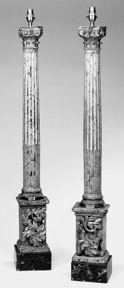 A pair of polychrome wood colu