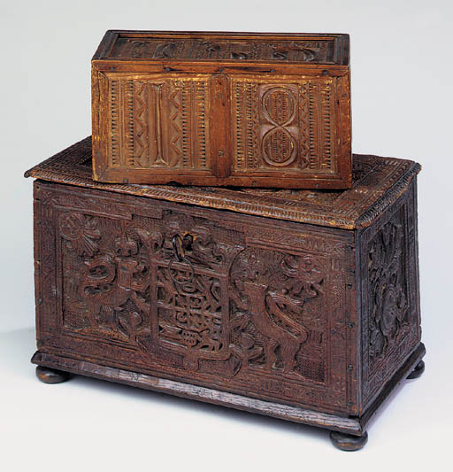 A carved oak box, probably Sca