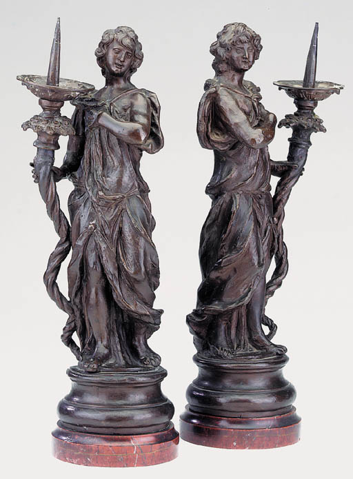 A pair of Italian bronze candl