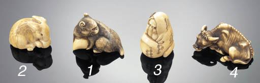 An ivory netsuke of a wild boa