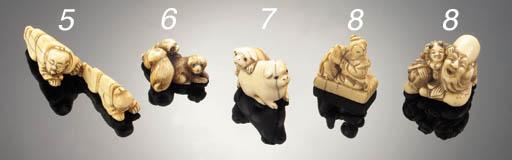 An ivory netsuke of two puppie