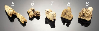 An ivory netsuke of a seated l