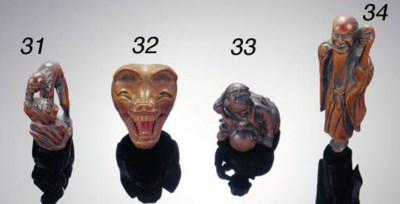 A wood netsuke of a fox mask 1