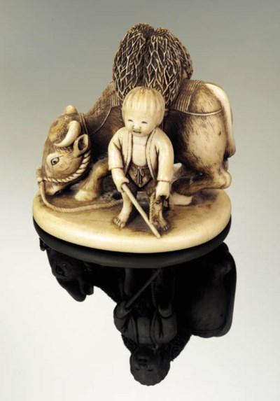 An ivory netsuke of a boy and