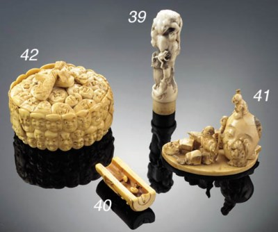 An ivory okimono of a mask-mak