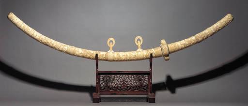 A massive ivory mounted tachi