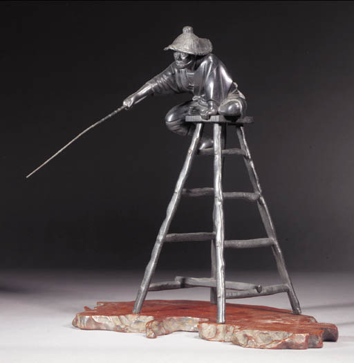 A bronze model of a fisherman