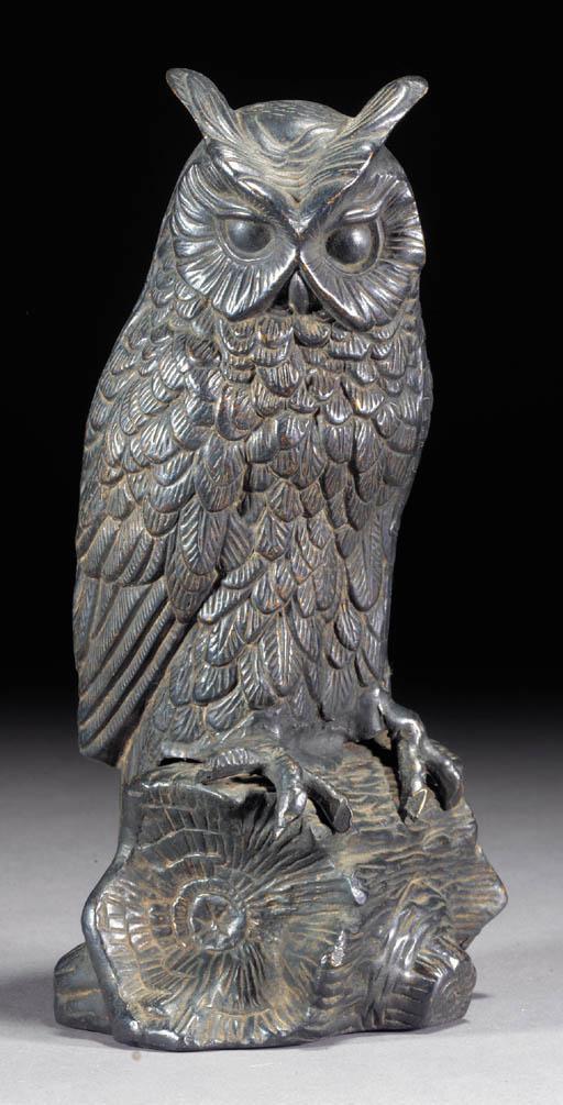 A bronze model of an owl 19th