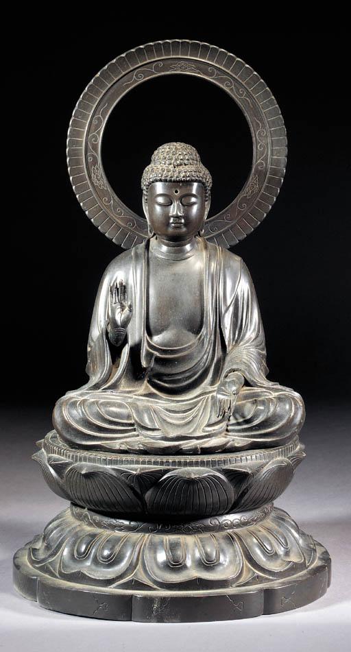 A bronze seated Buddha on stan