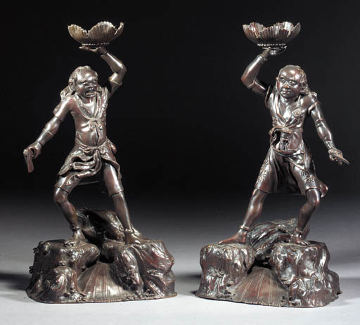 A pair of bronze figural candl