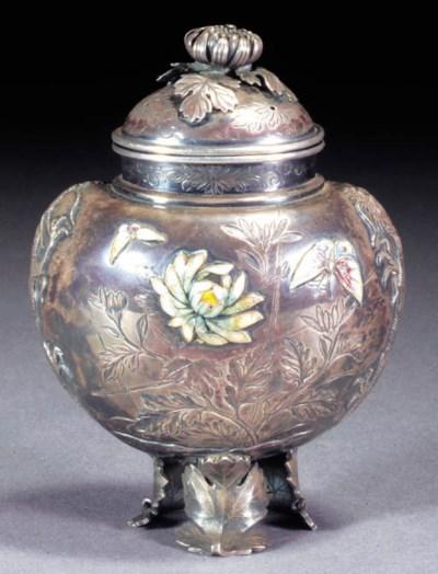 A silver and enamel tripod kor