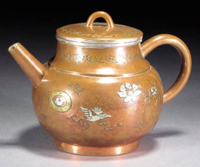 A copper and inlaid teapot and