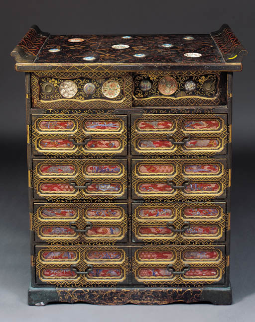 A lacquered wooden cabinet wit