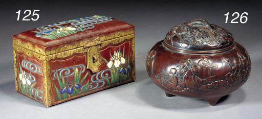 A bronze tripod koro and cover