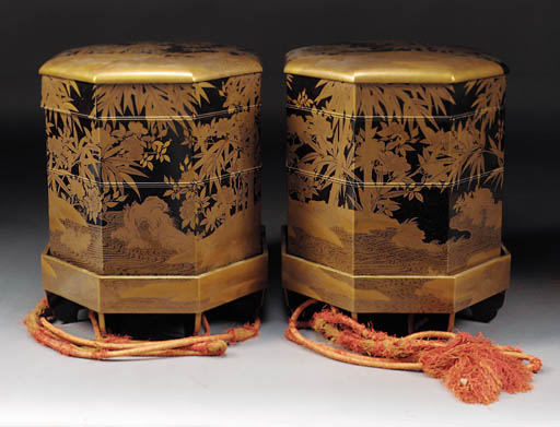 A pair of gold and black lacqu