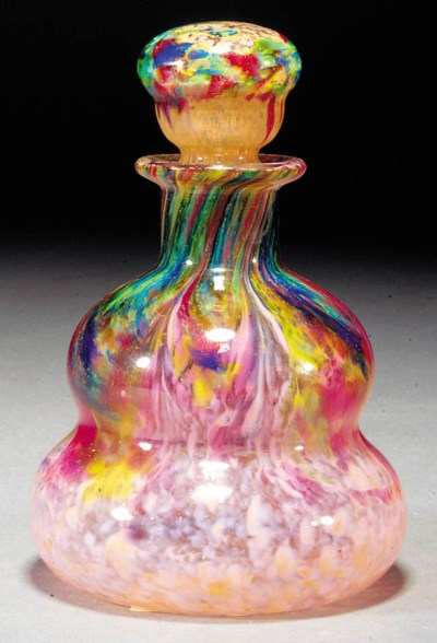 A Monart perfume bottle and st
