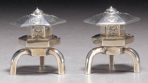 A pair of white metal salts