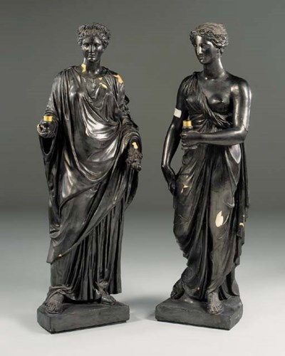 A pair of plaster figural torc
