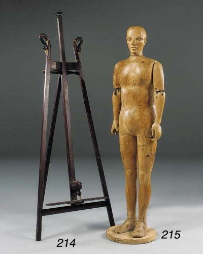 A carved pine figure of a man,