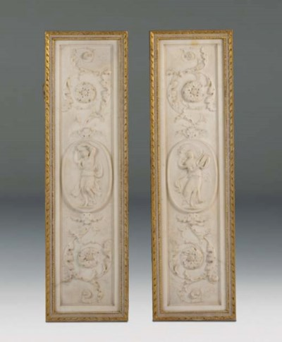 A pair of sculpted white marbl