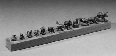 A set of twelve miniature bron