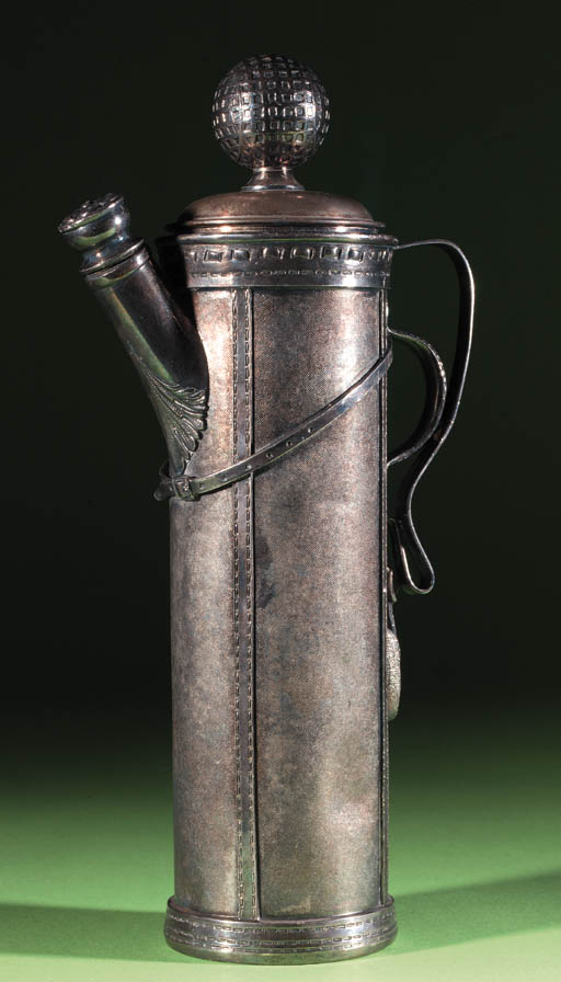 A WHITE-METAL COCKTAIL SHAKER