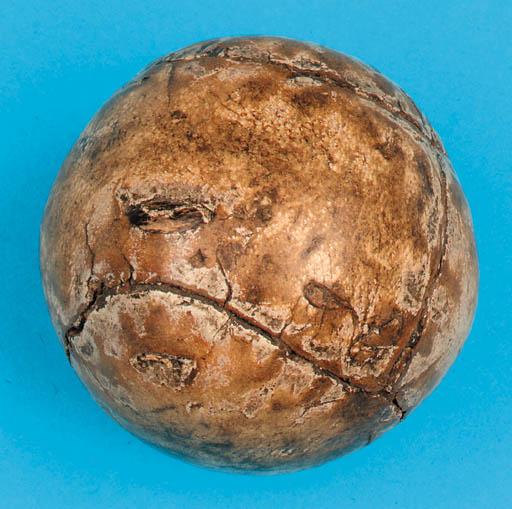 A FEATHER-FILLED GOLF BALL