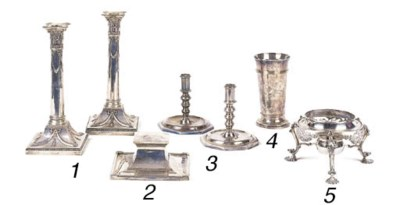 A pair of metalware candlestic