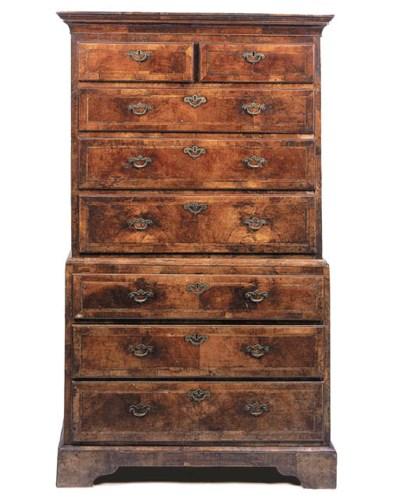 A walnut tallboy chest