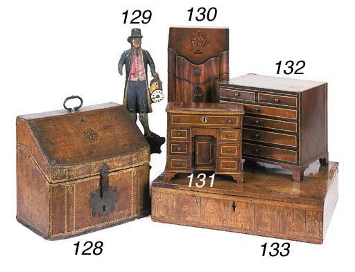 A gilt-tooled leather veneered