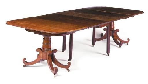A mahogany twin pillar dining