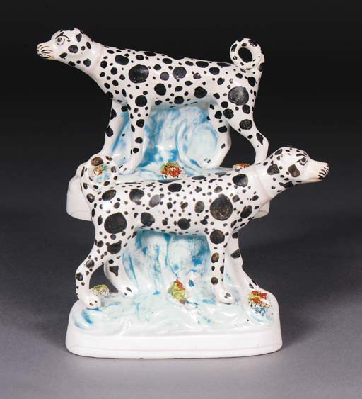 A pair of Staffordshire models of dalmations