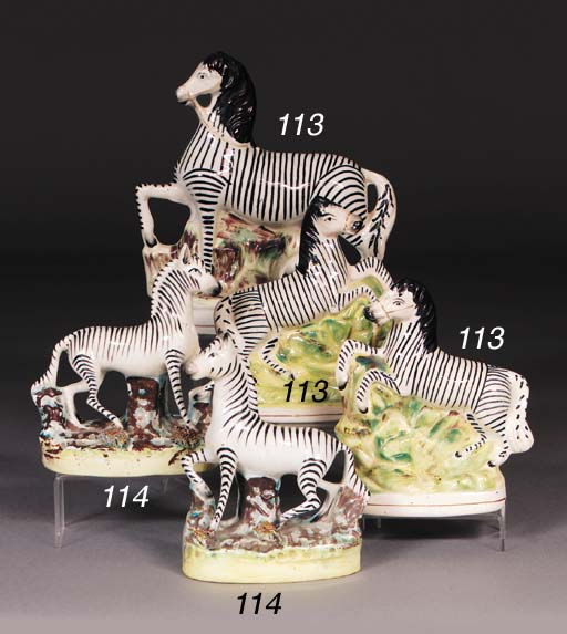 Two Staffordshire models of zebra