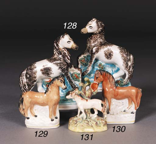 A pair of Staffordshire models circus ponies